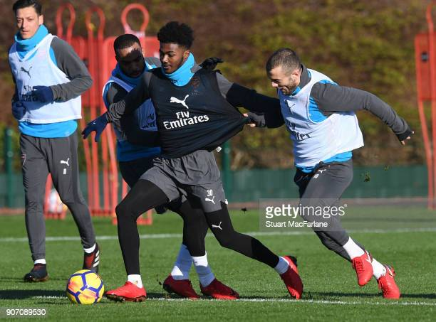 Alex Lacazette Ainsley MaitlandNiles and Jack Wilshere of Arsenal during a training session at London Colney on January 19 2018 in St Albans England