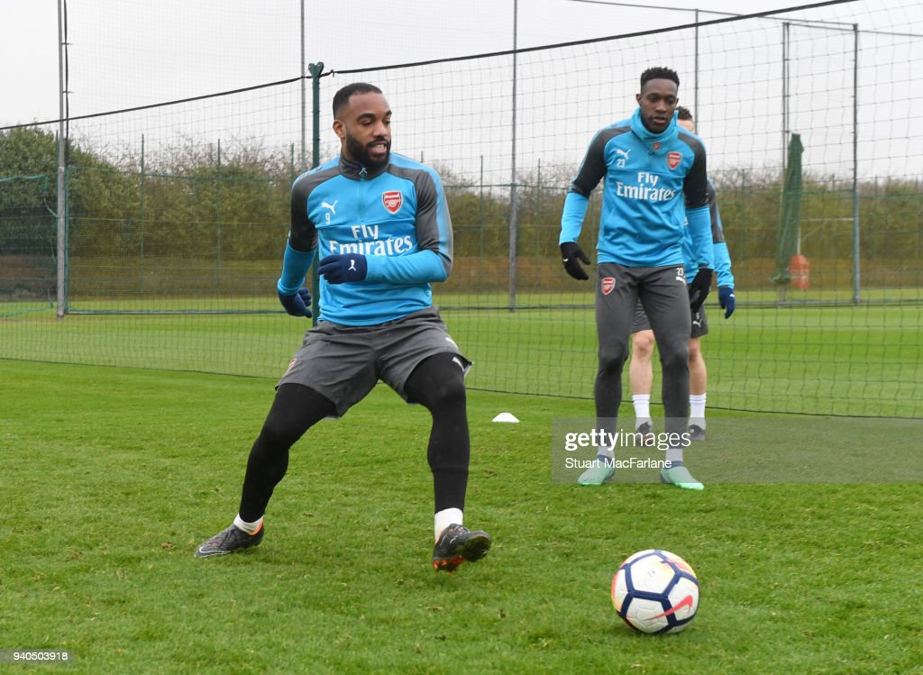 Alex Lacazette and Danny Welbeck of Arsenal during a training session at London Colney on March 31, 2018 in St Albans, England.