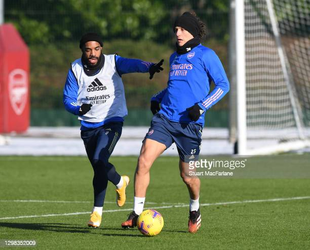 Alex Lacazette and David Luiz of Arsenal during a training session at London Colney on January 25, 2021 in St Albans, England.