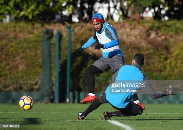 Alex Lacazette and David Ospina of Arsenal during a training session at London Colney on December 9 2017 in St Albans England