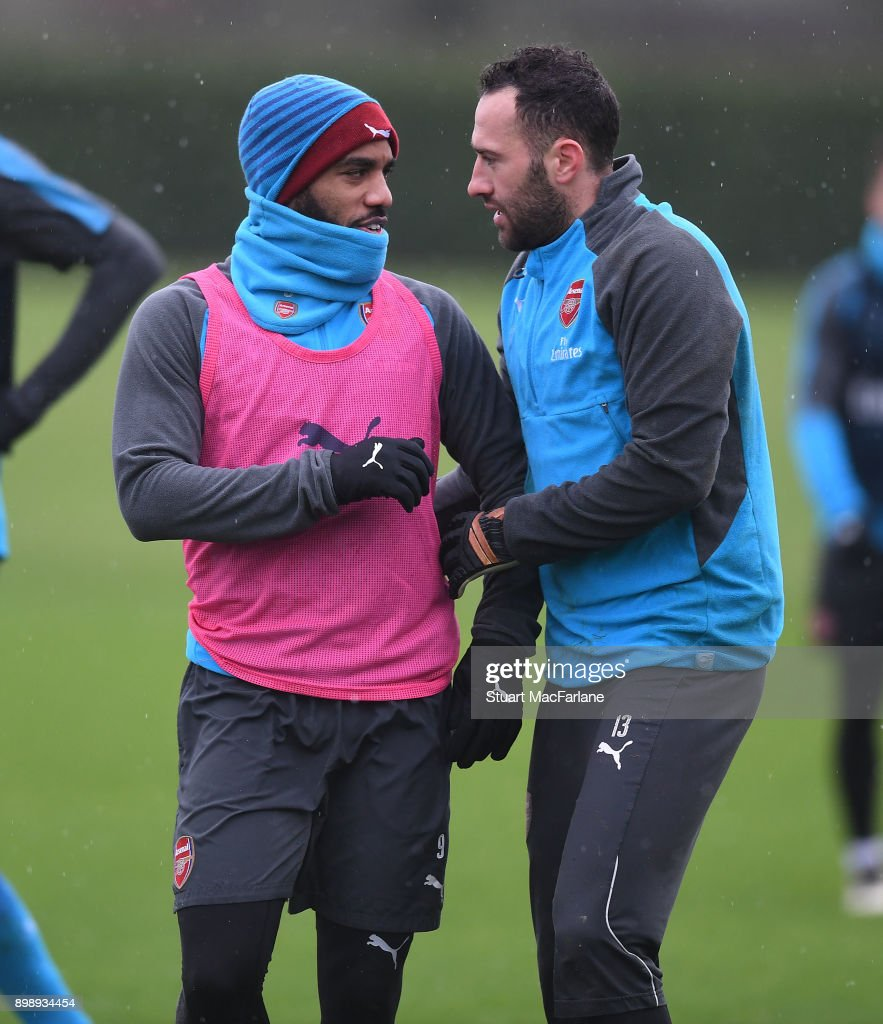 Alex Lacazette and David Ospina of Arsenal during a training session at London Colney on December 27, 2017 in St Albans, England.