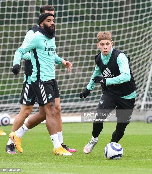 Alex Lacazette and Emile Smith Rowe of Arsenal during a training session at London Colney on May 22, 2021 in St Albans, England.