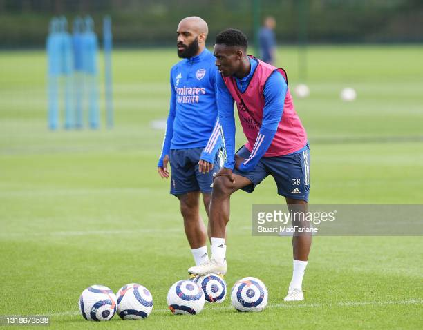 Alex Lacazette and Flo Balogun of Arsenal during a training session at London Colney on May 18, 2021 in St Albans, England.