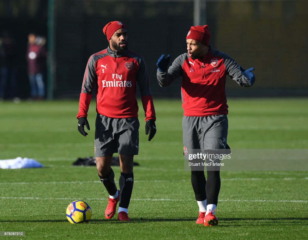 Alex Lacazette and Francis Coquelin of Arsenal during a training session at London Colney on November 17, 2017 in St Albans, England.