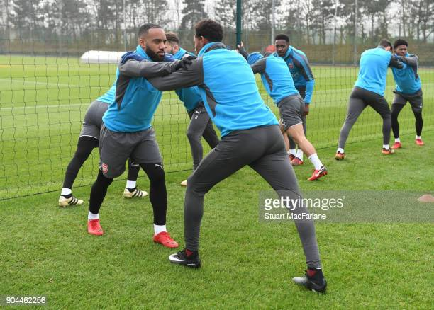 Alex Lacazette and Jeff ReineAdelaide of Arsenal during a training session at London Colney on January 13 2018 in St Albans England
