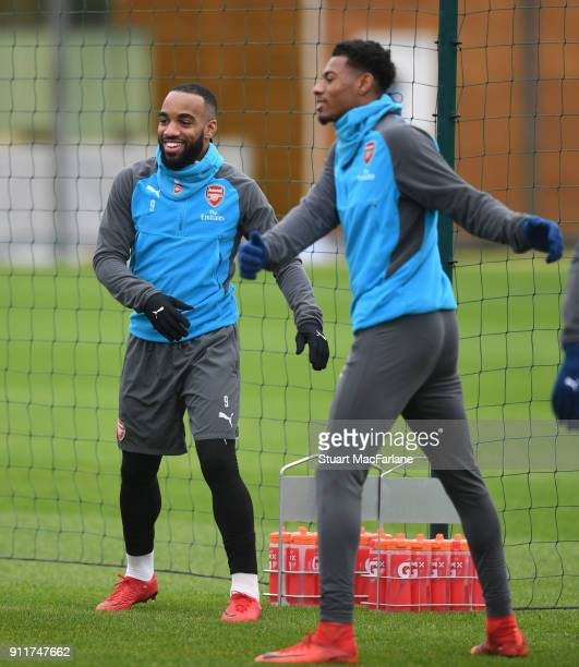 Alex Lacazette and Jeff ReineAdelaide of Arsenal during a training session at London Colney on January 29 2018 in St Albans England