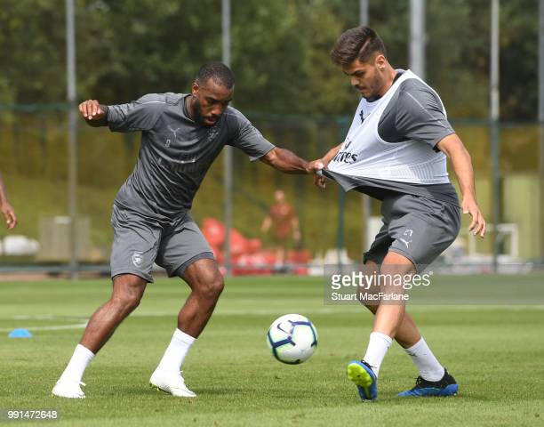 Alex Lacazette and Konstantinos Mavropanos of Arsenal during a training session at London Colney on July 4 2018 in St Albans England