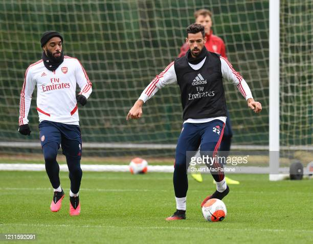 Alex Lacazette and Pablo Mari of Arsenal during a training session at London Colney on March 10 2020 in St Albans England