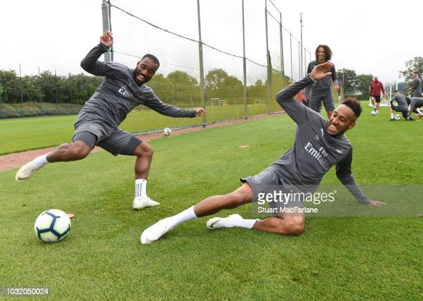 Alex Lacazette and PierreEmerick Aubameyang of Arsenal during a training session at London Colney on September 12 2018 in St Albans England
