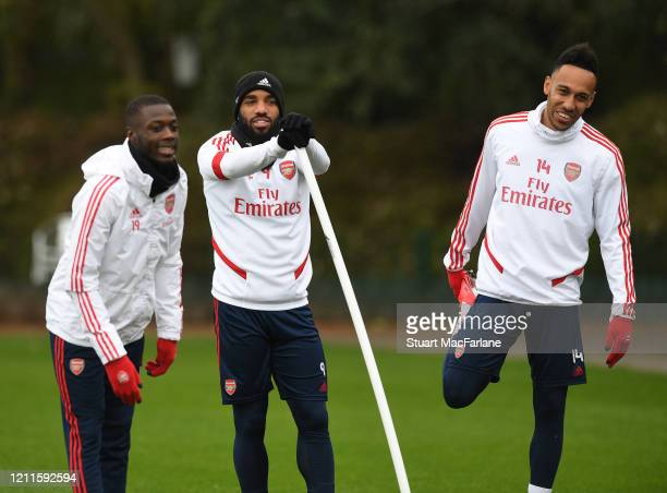 Alex Lacazette and PierreEmerick Aubameyang of Arsenal during a training session at London Colney on March 10 2020 in St Albans England
