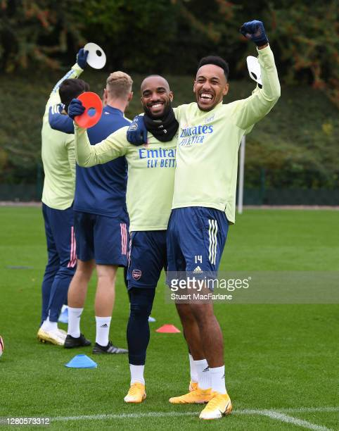 Alex Lacazette and PierreEmerick Aubameyang of Arsenal during a training session at London Colney on October 16 2020 in St Albans England