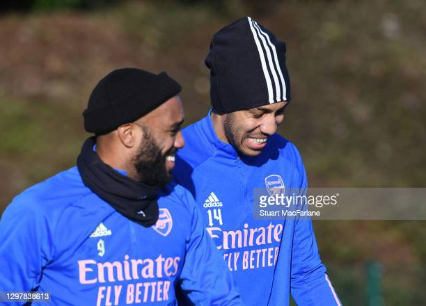 Alex Lacazette and Pierre-Emerick Aubameyang of Arsenal during a training session at London Colney on January 22, 2021 in St Albans, England.