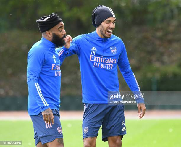 Alex Lacazette and Pierre-Emerick Aubameyang of Arsenal during a training session at London Colney on May 18, 2021 in St Albans, England.