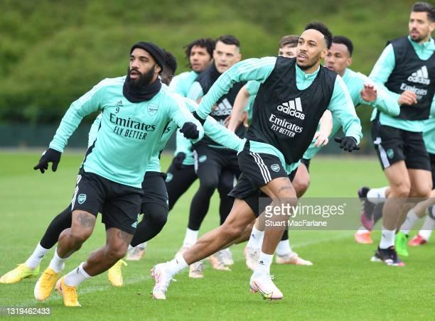 Alex Lacazette and Pierre-Emerick Aubameyang of Arsenal during a training session at London Colney on May 22, 2021 in St Albans, England.