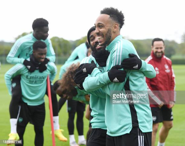 Alex Lacazette and Pierre-Emerick Aubameynag of Arsenal during a training session at London Colney on May 22, 2021 in St Albans, England.