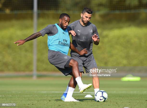 Alex Lacazette and Sead Kolasinac of Arsenal compete for the ball during a training session at London Colney on July 9 2018 in St Albans England