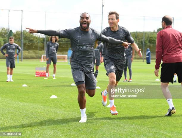 Danny Welbeck and Alex Lacazette of Arsenal during a training session at London Colney on August 17 2018 in St Albans England