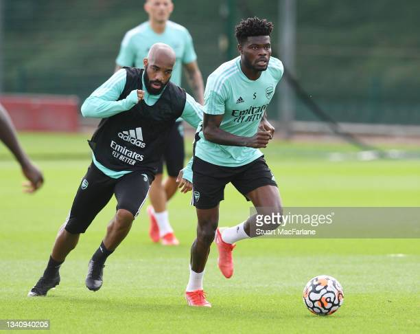Alex Lacazette and Thomas Partey of Arsenal during a training session at London Colney on September 17, 2021 in St Albans, England.