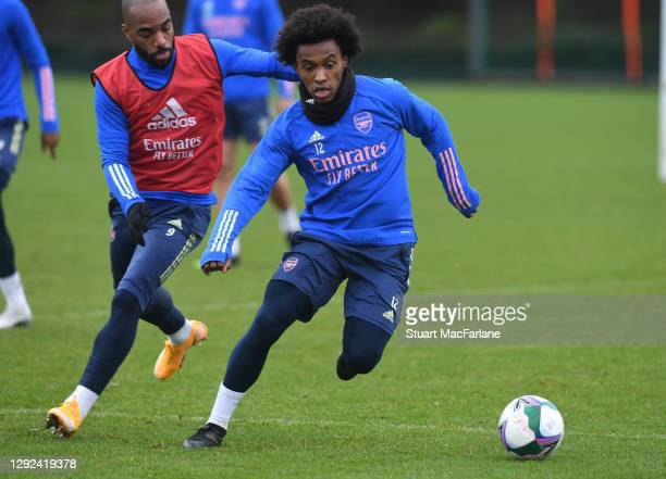 Alex Lacazette and Willian of Arsenal during a training session at London Colney on December 21, 2020 in St Albans, England.