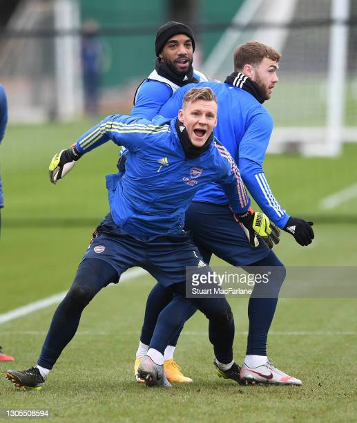 Alex Lacazette, Bernd Leno and Calum Chambers of Arsenal during a training session at London Colney on March 05, 2021 in St Albans, England.