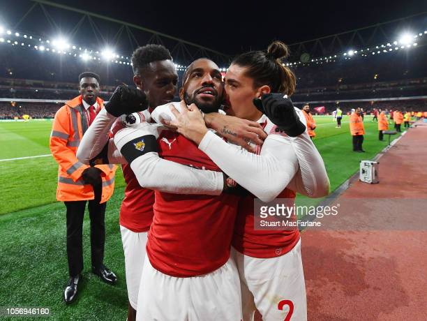 Alex lacazette celebrares scoring the Arsenal goal with Danny Welbeck and Hector Bellerin during the Premier League match between Arsenal FC and...