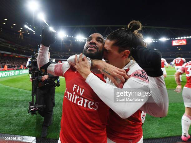 Alex lacazette celebrares scoring the Arsenal goal with Hector Bellerin during the Premier League match between Arsenal FC and Liverpool FC at...
