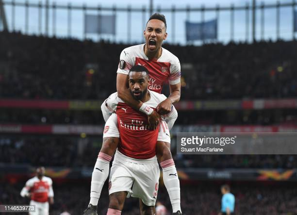 Alex Lacazette celebrates scoring for Arsenal with PierreEmerick Aubameyang during the UEFA Europa League Semi Final First Leg match between Arsenal...