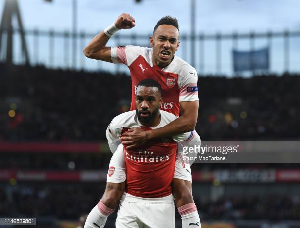 Alex Lacazette celebrates scoring for Arsenal with PierreEmerick Aubameyang during the UEFA Europa League Semi Final First Leg match between Arsenal...