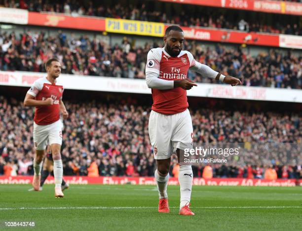 Alex Lacazette celebrates scoring the 1st Arsenal goal during the Premier League match between Arsenal FC and Everton FC at Emirates Stadium on...
