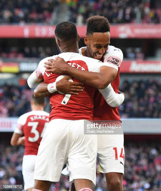 Alex Lacazette celebrates scoring the 1st Arsenal goal with PierreEmerick Aubameyang during the Premier League match between Arsenal FC and Everton...