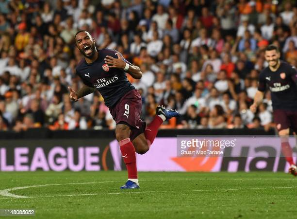 Alex Lacazette celebrates scoring the 2nd Arsenal goal during the UEFA Europa League Semi Final Second Leg match between Valencia and Arsenal at...