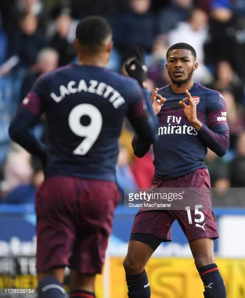 Alex Lacazette celebrates scoring the 2nd Arsenal goal with Ainsley MaitlandNiles during the Premier League match between Huddersfield Town and...