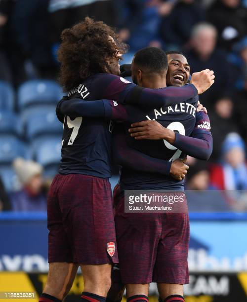 Alex Lacazette celebrates scoring the 2nd Arsenal goal with Ainsley MaitlandNiles and Matteo Guendouzi during the Premier League match between...