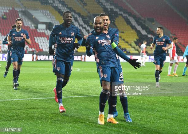 Alex Lacazette celebrates scoring the 2nd Arsenal goal with Dani Ceballos and Nicolas Pepe during the UEFA Europa League Quarter Final Second Leg...