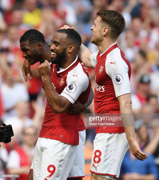 Alex Lacazette celebrates scoring the 3rd Arsenal goal with Ainsley MaitlandNiles and Aaron Ramsey during the Premier League match between Arsenal...