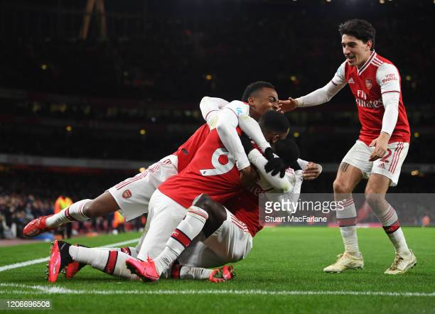 Alex Lacazette celebrates scoring the 4th Arsenal goal with Joe Willock and Hector Bellerin during the Premier League match between Arsenal FC and...
