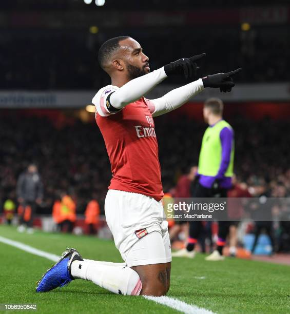 Alex Lacazette celebrates scoring the Arsenal goal during the Premier League match between Arsenal FC and Liverpool FC at Emirates Stadium on...
