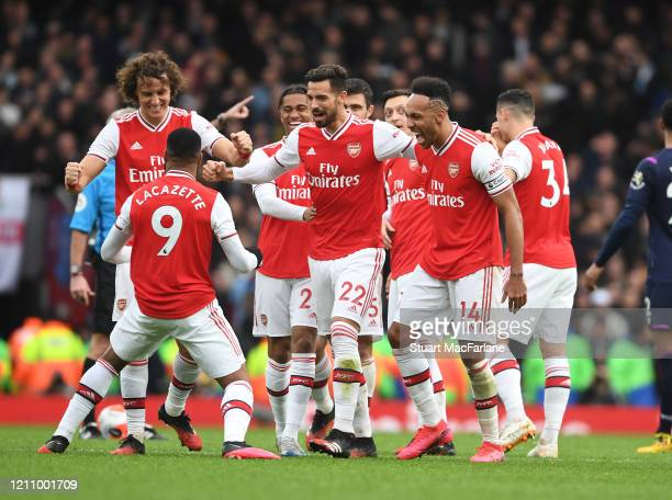 Alex Lacazette celebrates scoring the Arsenal goal with David Luiz Pablo Mari and PierreEmerick Aubameyang during the Premier League match between...