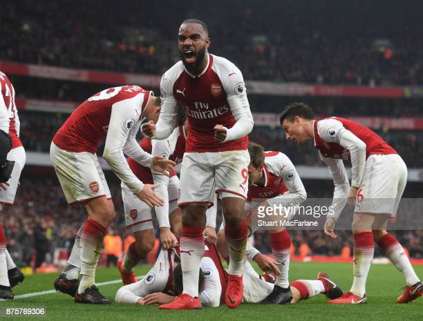 Alex Lacazette celebrates the 1st Arsenal goal scored by Shkodran Mustafi during the Premier League match between Arsenal and Tottenham Hotspur at...