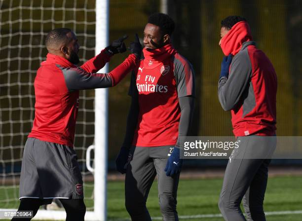 Alex Lacazette Danny Welbeck and Jeff ReineAdelaide of Arsenal before a training session at London Colney on November 25 2017 in St Albans England