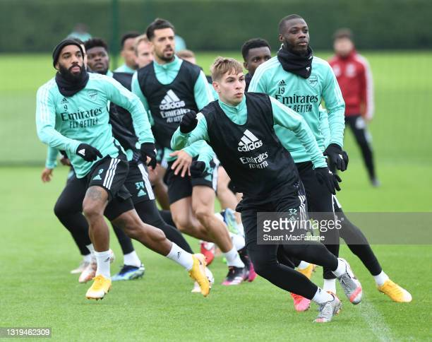 Alex Lacazette, Emile Smith Rowe and Nicolas Pepe of Arsenal during a training session at London Colney on May 22, 2021 in St Albans, England.