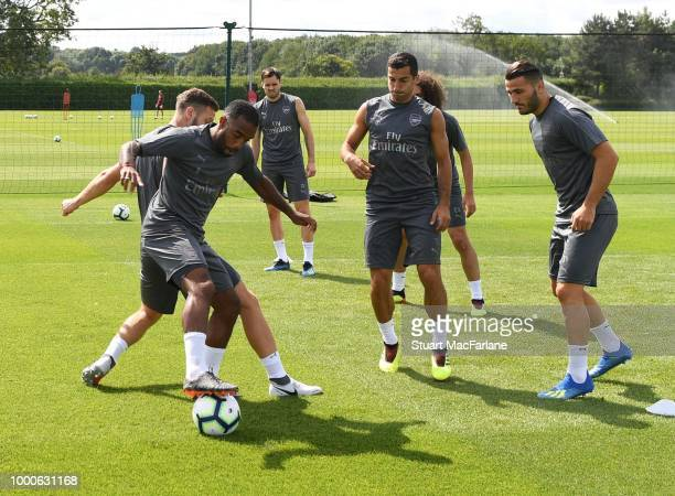 Alex Lacazette Henrikh Mkhitaryan and Sead Kolasinac of Arsenal during a training session at London Colney on July 17 2018 in St Albans England