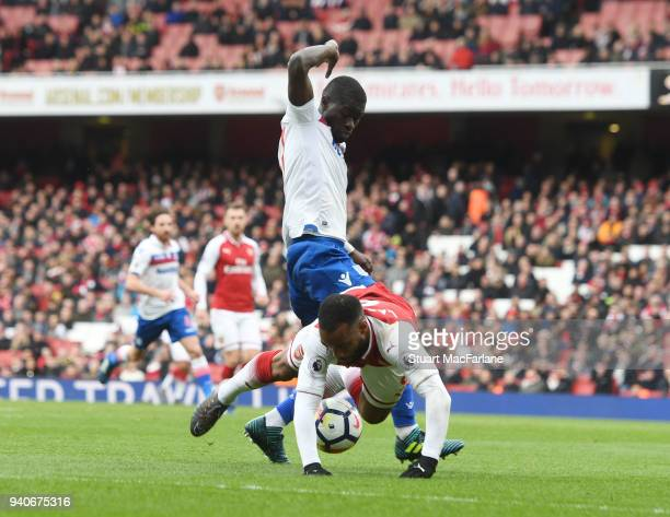 Alex Lacazette is tripped for the 2nd Arsenal penalty by Stoke defender Badou Ndiaye during the Premier League match between Arsenal and Stoke City...
