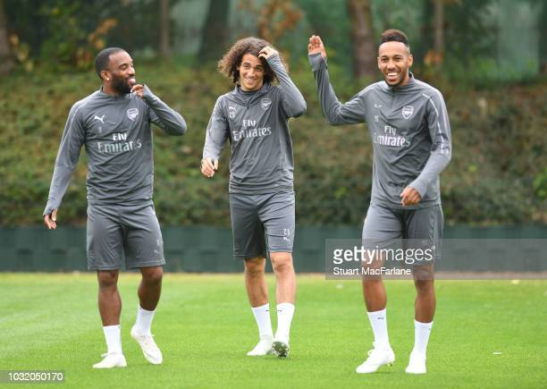 Alex Lacazette Matteo Guendouzi and PierreEmerick Aubameyang of Arsenal during a training session at London Colney on September 12 2018 in St Albans...