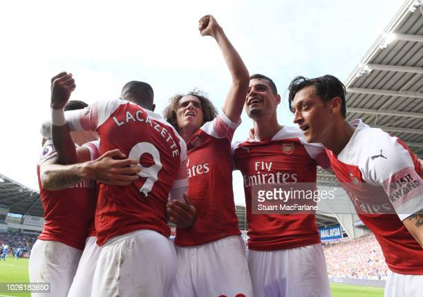 Alex Lacazette Matteo Guendouzi Granit Xhaka and Mesut Ozil celerbate the 2nd Arsenal goal during the Premier League match between Cardiff City and...