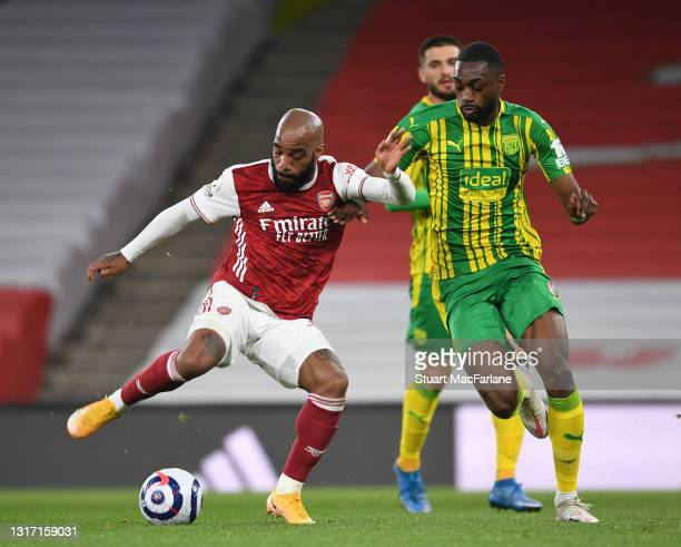 Alex Lacazette of Arsenal challenged by Semi Ajayi of West Brom during the Premier League match between Arsenal and West Bromwich Albion at Emirates...