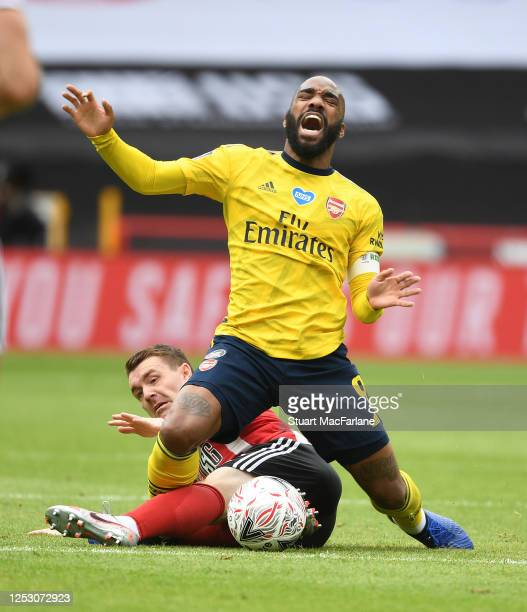 Alex Lacazette of Arsenal fouled by John Fleck of Sheffield United during the FA Cup Fifth Quarter Final match between Sheffield United and Arsenal...