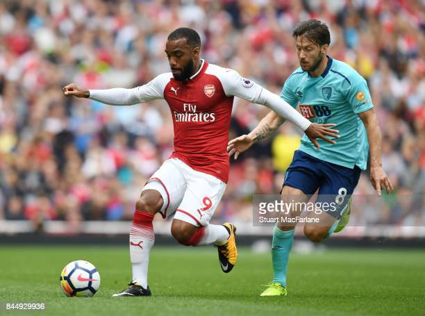 Alex Lacazette of Arsenal holds off Harry Arter of Bournemouth during the Premier League match between Arsenal and AFC Bournemouth at Emirates...