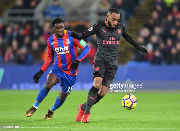 Alex Lacazette of Arsenal holds off Jeffrey Schlupp of Palace during the Premier League match between Crystal Palace and Arsenal at Selhurst Park on...