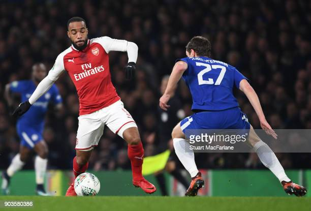 Alex Lacazette of Arsenal takes on Andreas Christensen of Chelsea during the Carabao Cup SemiFinal First Leg match between Chelsea and Arsenal at...